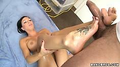 Rachel Starr pets long skin snake with her nice, tattooed feet