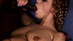 Curly blonde babe Luba loves the creamy vanilla center of his big black dick