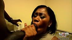 Hot ebony action as she slurps his big dark boner in the office bathroom