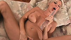 Lustful blonde milf with splendid boobs spreads her hot legs and pleases her juicy cunt