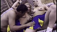 In the locker room, two wonderful cheerleaders get together and share a big dick