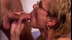 Lustful mature lady has two young dudes pounding her tight holes all over the bed