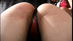 Busty slave gets her ass and titties punished by her black mistress