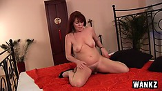 Lustful redhead lady loves to have the young stud fucking her peach doggy style