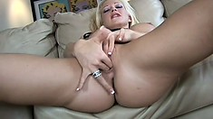 Buxom blonde spreads her luscious legs and fingers her wet snatch until she cums