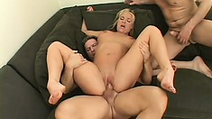 This blonde bombshell's tight pussy makes two cocks shoot their juices