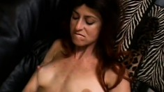 Naughty mature woman caresses her big boobs and pleases her needy cunt