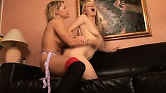 Anita Blue fills her friend's slit with a large strap-on toy